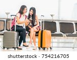two young asian girl using... | Shutterstock . vector #754216705