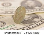 rusty coins on the old dollar... | Shutterstock . vector #754217809