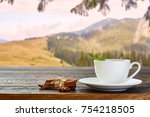 cup with tea on table over... | Shutterstock . vector #754218505
