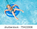Swimming - little girl playing in swimming pool - stock photo