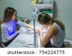 manicure in a beauty salon.... | Shutterstock . vector #754224775