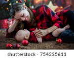 happy young mother and her son... | Shutterstock . vector #754235611