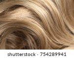 long blond hair as background   Shutterstock . vector #754289941
