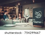 Served table in a restaurant. - stock photo