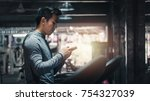 young handsome man exercising... | Shutterstock . vector #754327039