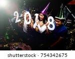 group of joyful colleagues... | Shutterstock . vector #754342675