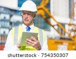 senior engineer man in suit and ... | Shutterstock . vector #754350307