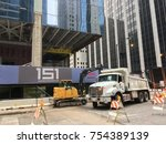 Small photo of CHICAGO, ILLINOIS-NOVEMBER 11, 2017: Loader removes construction material into dump truck by new CNA office high rise project in Loop.