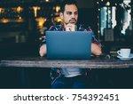 pondering hipster guy sitting... | Shutterstock . vector #754392451