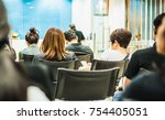 bank customers are sitting and... | Shutterstock . vector #754405051