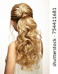blonde girl with long and shiny ... | Shutterstock . vector #754411681