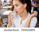 elegant  good looking woman... | Shutterstock . vector #754422895