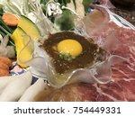 yellow yolk cup in the middle... | Shutterstock . vector #754449331