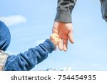 stylish hands of a parent and... | Shutterstock . vector #754454935