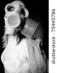 Girl in gasmask and lingerie against black background in black and white