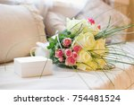 gift box and bouquet flowers on ... | Shutterstock . vector #754481524