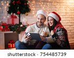 lovely charming couple sitting...   Shutterstock . vector #754485739