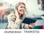 happy woman watching media...   Shutterstock . vector #754493731