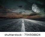 asphalted road at sunset | Shutterstock . vector #754508824