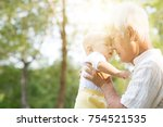 grandfather kissing baby... | Shutterstock . vector #754521535