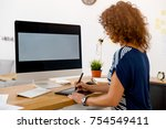 middle age designer working on... | Shutterstock . vector #754549411