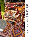 eastern carpets on the street | Shutterstock . vector #754551739