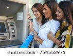 Young Friend Using Atm Machine...