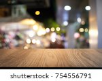 empty wood table top and blur... | Shutterstock . vector #754556791