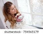 hands holding hot cup of coffee ... | Shutterstock . vector #754565179