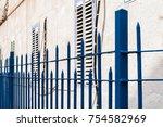 turquoise doors and windows of... | Shutterstock . vector #754582969