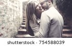 young happy young couple is... | Shutterstock . vector #754588039