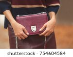 woman holding fashion red bag... | Shutterstock . vector #754604584