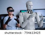 human wearing vr headset and... | Shutterstock . vector #754613425