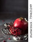 pomegranate fruit over black... | Shutterstock . vector #754621249
