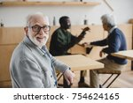 handsome senior man sitting in... | Shutterstock . vector #754624165