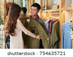 young woman helping her... | Shutterstock . vector #754635721