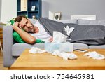 sick man lying on sofa and... | Shutterstock . vector #754645981
