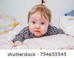 little white baby girl  lying...   Shutterstock . vector #754655545