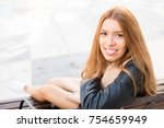 happy beautiful girl resting on ... | Shutterstock . vector #754659949