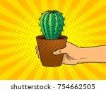 hand holds cactus pop art retro ... | Shutterstock .eps vector #754662505