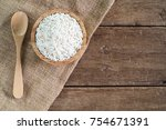 raw white sticky rice in wood... | Shutterstock . vector #754671391
