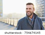 happy man standing outdoors... | Shutterstock . vector #754674145