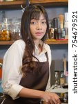 girl barista bartender waiter... | Shutterstock . vector #754679521