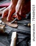 work in leather shop on dark... | Shutterstock . vector #754684315