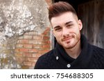 attractive guy in a old house... | Shutterstock . vector #754688305