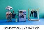 robot automation laundry room.... | Shutterstock . vector #754694545