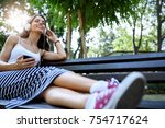 beautiful young woman sitting... | Shutterstock . vector #754717624