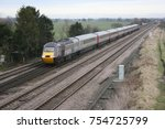 Small photo of Cross Country Trains Class 43 HST numbers 43384 & 43321 at Colton Junction, Yorkshire, UK - 17th February 2009