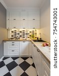 small kitchen with modern black ... | Shutterstock . vector #754743001