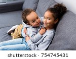 african american sister sitting ... | Shutterstock . vector #754745431